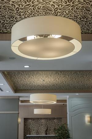 ceiling plate: Interior of modern restaurant room with lamps Editorial