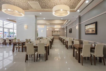Interior of modern restaurant room with wooden furniture Editöryel