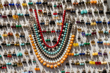jeweled: Jewelry ornaments made of various materials with wide variety of colors Stock Photo