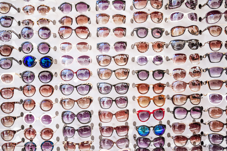 protecting spectacles: MUGLA , TURKEY - AUGUST 29, 2015: Colorful Sunglasses on sale at city market Editorial