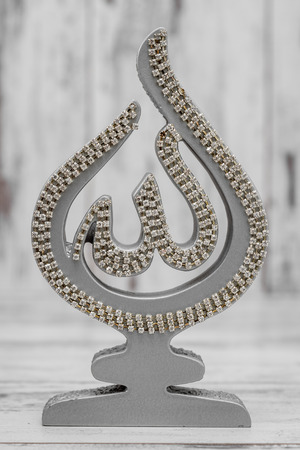 statuettes: Silver and Golden Religious statuettes with the name of Allah, the God written on it Stock Photo