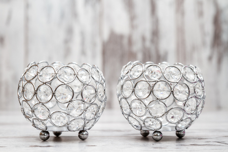 holders: Candle holders with crystals on white wooden background
