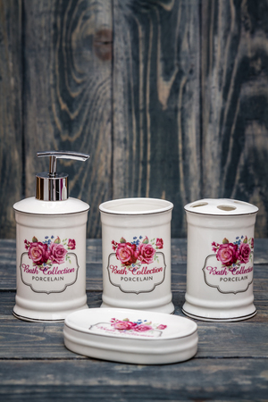 sanitizing: Set of cute white bathroom accessories with flower design Stock Photo