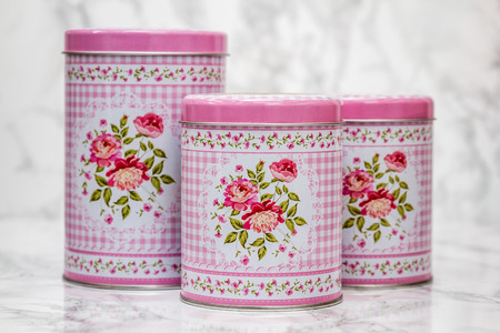 Decorative tin boxes with floral pattern on white marble background Stok Fotoğraf