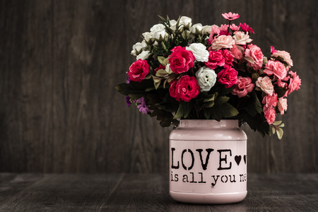 Artificial colorful flowers in a pink flower vase stock photo artificial colorful flowers in a pink flower vase stock photo 60054931 mightylinksfo