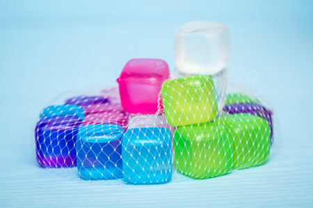 icecubes: Colorful plastic ice cubes on blue background