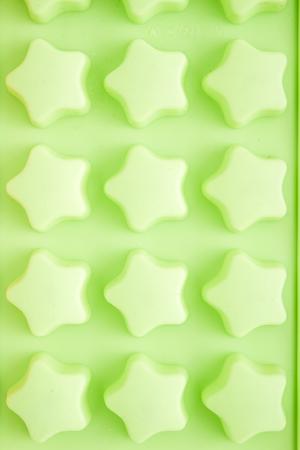 silicio: molde de silicona de colores vacío para la fabricación de chocolate Foto de archivo