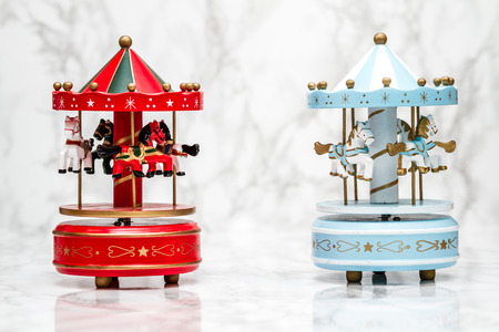 carnival ride: Wooden carousel horses with old vintage look on marble background