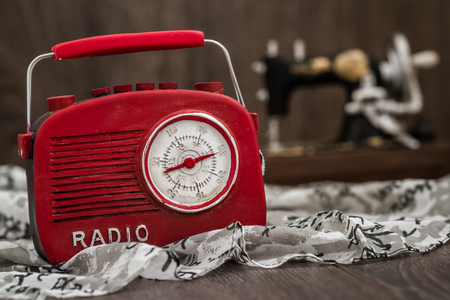 fm: Decorative red radio with retro look on brown wooden background