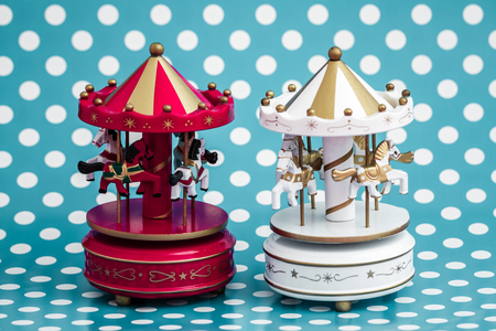 Wooden carousel horses with old vintage look on blue background
