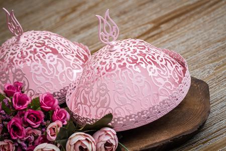 Decorative pink Turkish delight serving bowls on wooden background