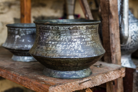 Big handmade forged copper cooking pots in an antique shop Stock Photo