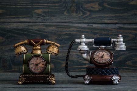 Desk clocks with antique telephone design on blue  background