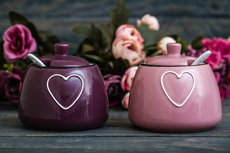 Colorful  porcelain spice jars with heart pattern and spoon Stock Photo