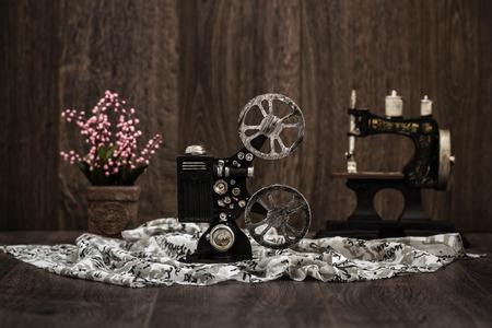Small nostalgic decorative film camera on brown wooden background Stock Photo