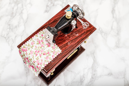 Music box with a shape of vintage sewing machine on white