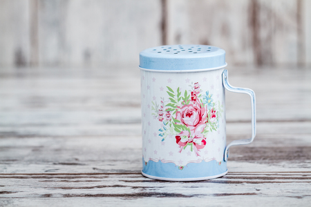 Blue tin metal powdered sugar shaker with floral pattern