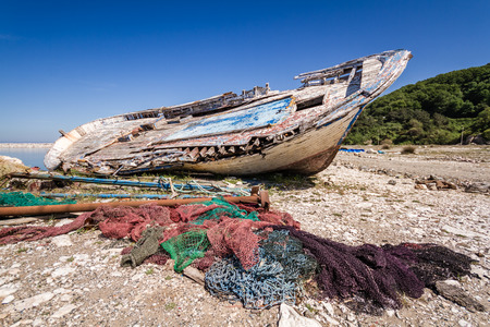 Old fishing boat abandoned on the shore