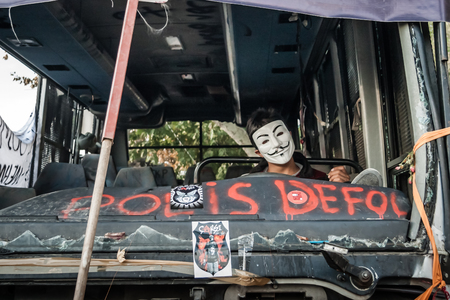ISTANBUL, TURKEY - JUNE 5, 2013 : Masked Protestor Seats on the Driver Seat of a Destroyed City Bus , after first Gezi Park Protests