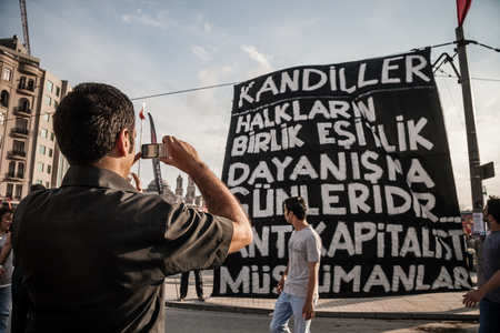ISTANBUL, TURKEY - JUNE 5, 2013 : Civilians visiting the Gezi Park and Taksim Square after first Gezi Park protests