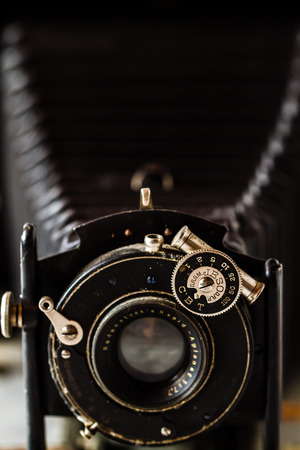 ESKISEHIR , TURKEY - AUGUST 28, 2018: Antique folding camera on marble background Redakční
