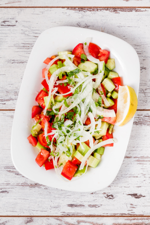 Delicious salad made from onion and tomato on white plate Stok Fotoğraf
