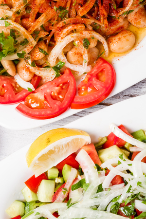 Delicious salad made from onion and tomato on white plate Stock Photo