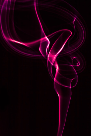Creative abstract pink smoke pattern on black background