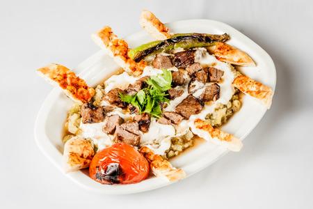 Turkish meat kebab with yoghurt and eggplant