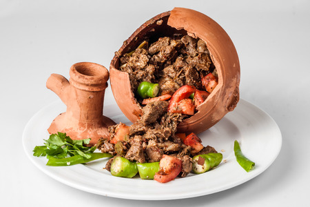 Authentic Turkish Testi Kebab cooked in earthenware waterjug Stock Photo