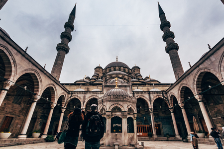 ISTANBUL, TURKEY - DEC 23, 2012: Tourists and visitors in front of the New Mosque