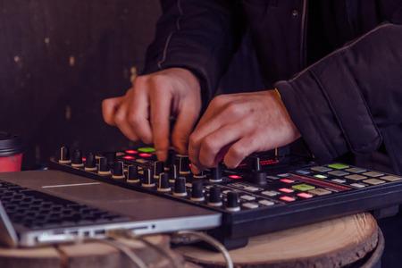 Sound engineer hands working on sound mixer