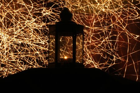 Silhouette of candle lamp with welding light