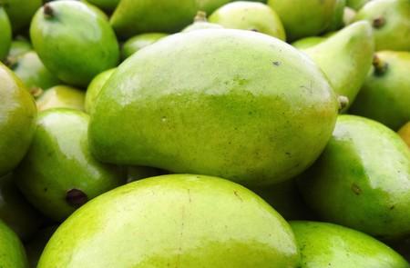 Green mango in the Honduran market Stock Photo