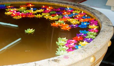 bath: Candles of faith in Buddhism