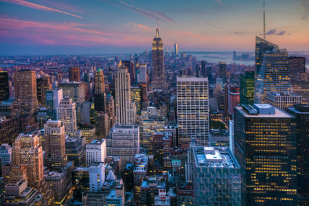 new york city times square: Manhattan Skyline at Dusk Stock Photo