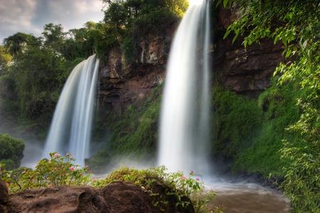 bordering: Double Falls at Iguazu Falls bordering Brazil and Argentina