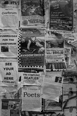 posted: Black and white of old advertisements posted to a wall Stock Photo