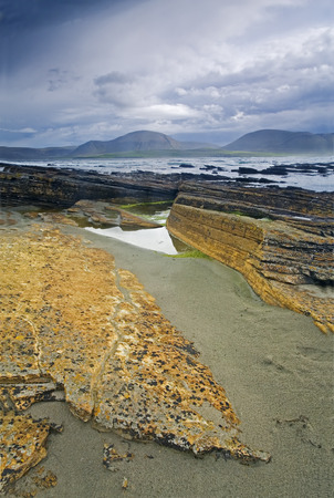 storm coming: Colorful Warbeth Bay in Orkney with a storm coming