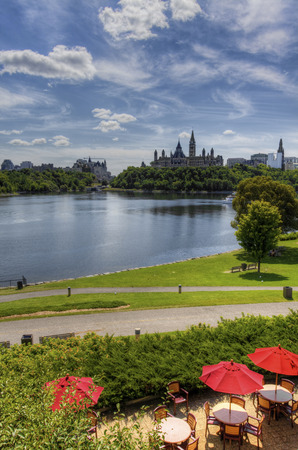 ottawa: The Parliament Buildings of Ottawa with umbrellas in foreground