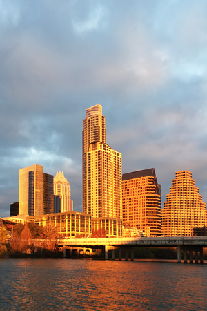 A Vertical of Austin skyline glowing at sunset