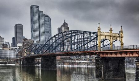 keystone: A Colorful bridge with Pittsburgh skyline
