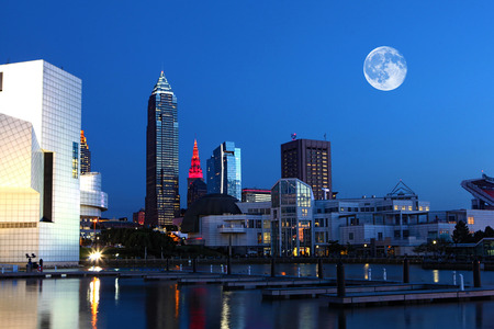 A Moon rising over Cleveland, Ohio Stock Photo