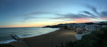 A Panorama of the beach at Albufeira, Portugal at sunset