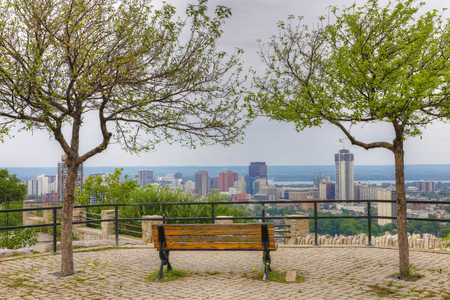 The Hamilton, Canada with park bench in foreground
