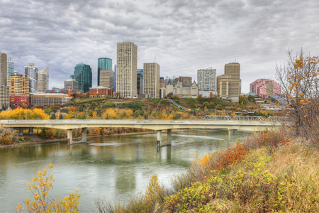 An Edmonton cityscape with colorful aspen in fall