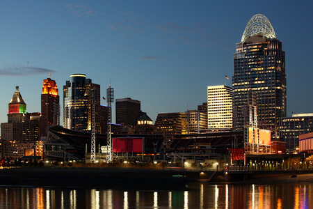 The Cincinnati skyline at night with reflections