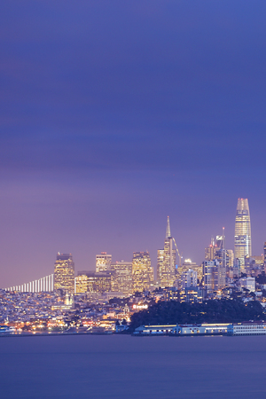 A Vertical night view of San Francisco across the water