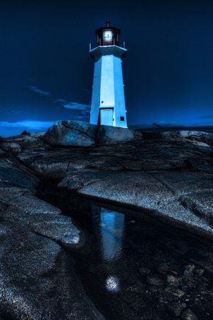 A Vertical of Peggy's Cove Lighthouse, Nova Scotia at night