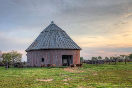 A Scene of Round Barn in Indiana, United States. Round barn is a historic barn design that could be octagonal, polygonal, or circular